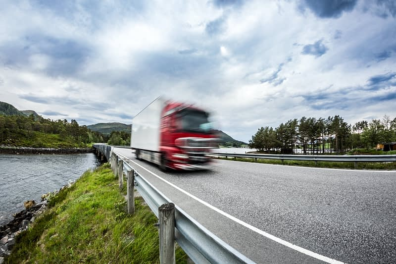 Fuel truck rushes down the highway, Norwey. Truck Car in motion blur.